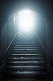 Old abandoned stairs going up to the light Stock Photo