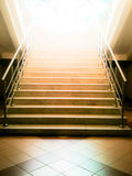 Old abandoned stairs going up to the light. Hope concept Stock Images