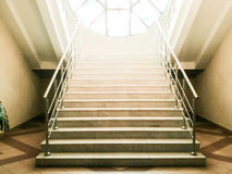 Old abandoned stairs going up to the light. Hope concept.  royalty free stock image