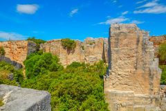 Old abandoned stone quarry Lithica Pedreres des Hostal. Stock Photos