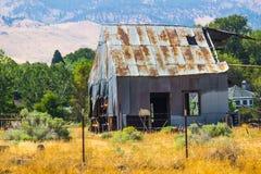 Old Abandoned Tin Barn In Disrepair. Old Rusty Tin Barn In Disrepair Stock Photos
