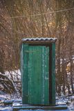 Old abandoned toilet in the village. Winter Royalty Free Stock Photography