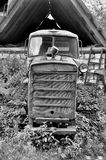 Old abandoned tracked tractor in russia Royalty Free Stock Photo