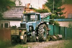 Old abandoned tractor in russia Royalty Free Stock Photo