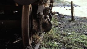 Old abandoned train wagon. Detail of the rusty wheels.