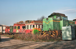 Old abandoned  trains at  depot in sunny day Stock Images