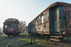 Old abandoned  trains at  depot in sunny day Stock Photos
