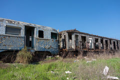 Old abandoned trains in sunny day Stock Image