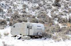 Old Abandoned Travel Trailer in Snow. An old abandoned travel trailer sitting in the snow in the Oregon desert stock photos