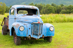 Old abandoned truck. Old abandoned farm truck in a rural country field Royalty Free Stock Image