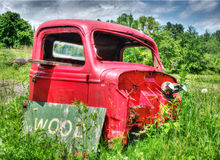 Old abandoned truck in farm field. Old Red Truck wasting away in a farm field Stock Photo