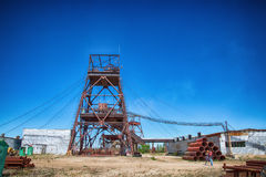 An old, abandoned underground mine. An old, abandoned underground mine of the naphone of a speckled landscape. The superstructure has rusted. Obsolete model Stock Photography