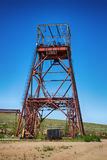 An old, abandoned underground mine. An old, abandoned underground mine of the naphone of a speckled landscape. The superstructure has rusted. Obsolete model Royalty Free Stock Photography