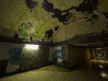 Old abandoned underground tunnel, walls with peeling paint and plaster stock images