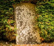 An old abandoned unmarked gravestone royalty free stock image