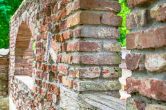 Old abandoned vintage rough stone castle wall ruins Royalty Free Stock Photography