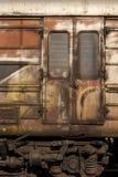 Old abandoned wagon grunge side. Old abandoned railway wagon grunge side as backgroung Stock Photo