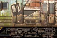 Old abandoned wagon grunge side. Old abandoned railway wagon grunge side as backgroung stock photography