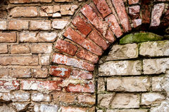 Old abandoned wall with bricked up window. Architecture detail background Royalty Free Stock Image