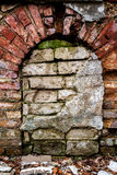Old abandoned wall with bricked up window. Architecture detail background Stock Photos