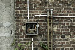 Old abandoned wall with electricity meter. This is photo of a wall and a broken window Royalty Free Stock Photos
