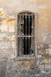 Old abandoned wall with one closed wooden window royalty free stock photography