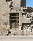 Old abandoned wall with one closed wooden window. Covered by broken wooden iron grid, El-Dard El-Ahmar, Cairo, Egypt Stock Photography