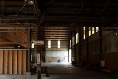 Old and abandoned warehouse. Factory in disrepair royalty free stock photo