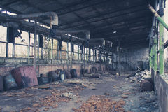 Old abandoned warehouse , empty messy factory Stock Photography