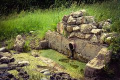 Old abandoned water spring Stock Photo