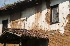Old abandoned weathered rural house facade royalty free stock photography