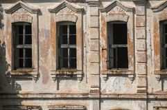 Old abandoned weathered house facade stock photo