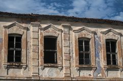 Old abandoned weathered house facade stock images