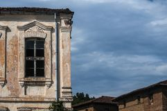 Old abandoned weathered house facade stock photography