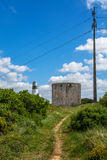 Old abandoned wind mill and power lines on the side. Torres Vedras Portugal. 18 May 2017.Old abandoned wind mill on Torres Vedras.Torres Vedras, Portugal royalty free stock image