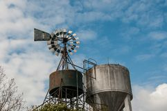 Old and abandoned wind vane. In a farm royalty free stock photography