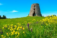 Old abandoned windmill. Ruins of old windmill tower on a field. Estonia, Baltic States, Europe royalty free stock photo