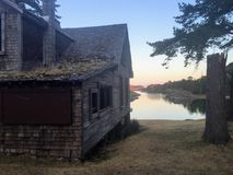 An old abandoned wood cabin overlooking the bays of Jebediah Isl stock photography