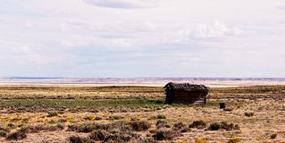 Old abandoned wood cabin. Old abandoned wood cabin in the Wyoming desert Stock Images