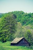 Old abandoned wooden barn. Traditional style of building in Ukrainian village in the past. Nature and ethnic of Eastern Europe stock photography