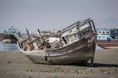 Old abandoned wooden boat in Bandare Loft village Royalty Free Stock Image