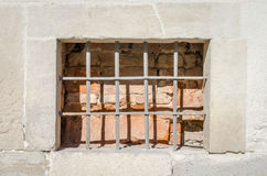 Old abandoned wooden box with glass of rusty metal bars in the concrete wall in a building of ancient architecture in Lviv Royalty Free Stock Photos