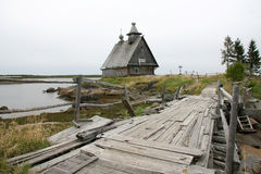 Old abandoned wooden church on the island on a cloudy day and th Royalty Free Stock Photo