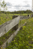 Old abandoned wooden fence, a fence, a meadow Stock Photo