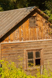 Old abandoned wooden house with broken window Stock Image
