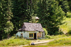 Old abandoned wooden house in forest Royalty Free Stock Images