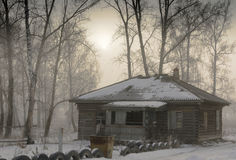 Old,abandoned wooden house in the village. Fog. royalty free stock image