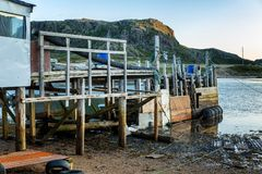 Old abandoned wooden pier on a sandy beach Royalty Free Stock Images