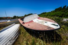 Old abandoned wrecked speed boat at ship or boat graveyard. Royalty Free Stock Photos