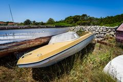 Old abandoned wrecked speed boat at ship or boat graveyard. Stock Photo